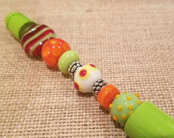 Lime Green Beaded Pen made with Beautiful Handmade Lampwork Beads in greens, oranges, yellows and reds