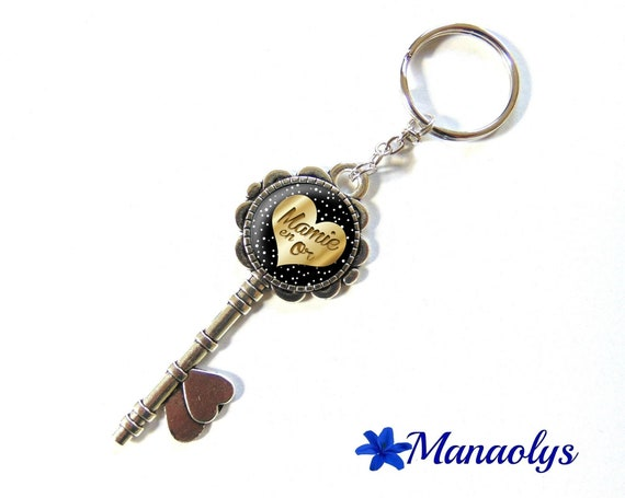 Key ring or jewelry bag, silver key and glass, Granny gold 101 cabochons