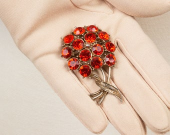 Mid Century Gold Brooch, Large red rhinestones form a bouquet of flowers with a ribbon on the stems, Red lapel brooch, Flower Brooch pin