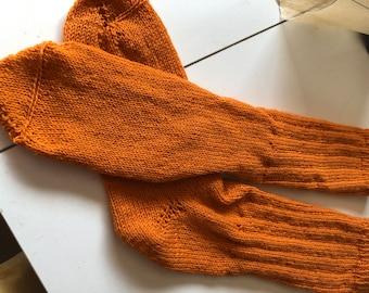Orange hand-knitted socks