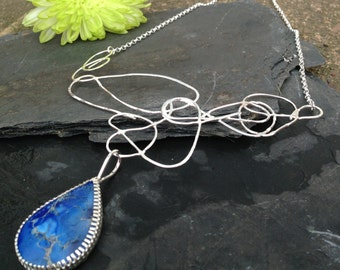 British handmade silver scribble necklace with blue sea bamboo pendant