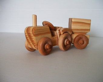 Wooden toy tractor and silo trailer