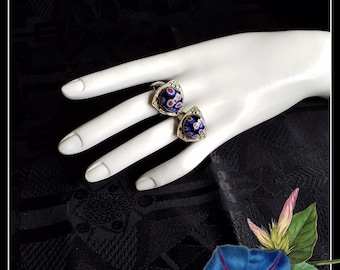 Two vintage silver, red and blue filigree rings