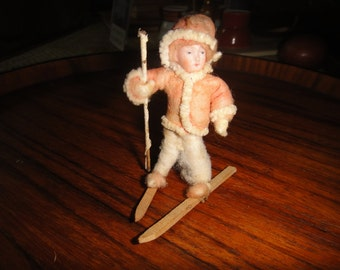 Vintage Skiier felt composition body and clothing face is ceramic composition