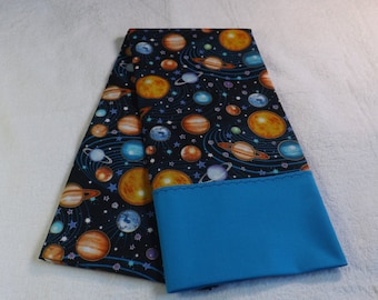 Pillowcase made from solar system cotton fabric with aqua border.