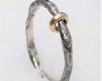 Thin ring with gold silver and diamonds