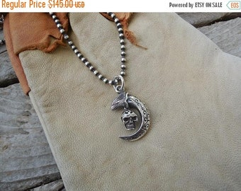 ON SALE Eagle Talon necklace handmade in sterling silver with a small skull