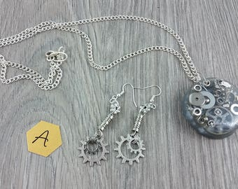 Necklace + Earrings: silver parts in resin pendant on chain; Steampunk