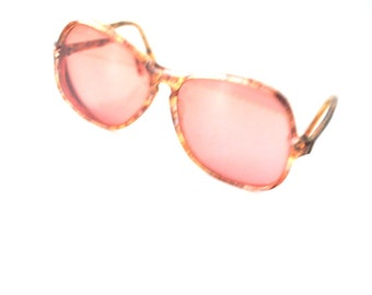 Retro vintage 80s, multicolor amber lucite , asymmetric frame,  optical sunglasses with a copper lenses. Made in France.