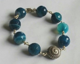 Shades of Blue banded agate crystal beads and Fine Silver Swirl shell ocean bracelet.