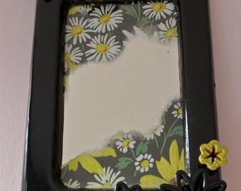 Vanity mirror w/ vintage floral wallpaper in black frame
