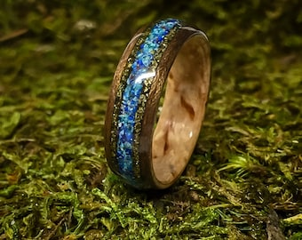 Masur Birch and Walnut Bent Wood Ring with a center inlay of Blue Bird Azurite Chrysocolla with two bands of gold Chalcopyrite on the sides.