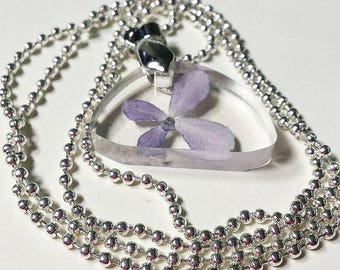 Pendant with a ball necklace containing a hydrangea flower. Pendant size 2 x 3 cm