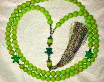 Extraordinary and unique lime green tasbih/misbaha accented with green starts and multicolored tassal