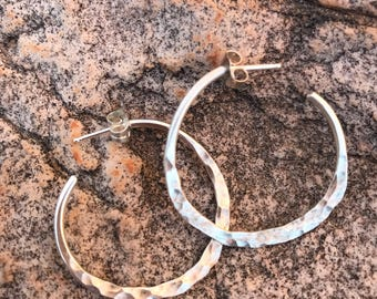 Sterling silver hand-forged esr hoops.