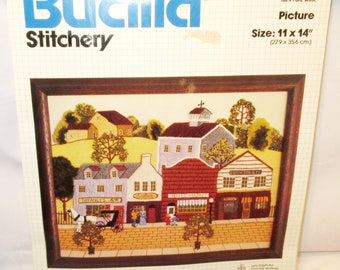 "Bucilla SATURDAY IN TOWN Crewel Embroidery Stitchery Kit 11x14"" Kit #49122 Picture Wall Hanging Early American Country Town Barn New Sealed"