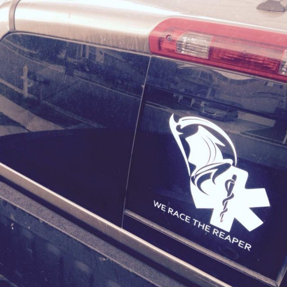 Ems sticker with faceless reaper asclepius and text we race the reaper vinyl car decal e00142