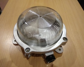 Sealed lamp in a military style for flammable or damp rooms.