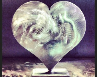 HEART POUNDING stainless steel sculpture