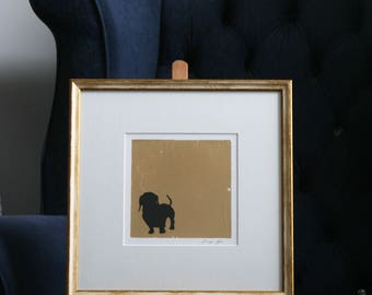 Hand painted Dachshund pen and ink silhouette on gold leaf on paper.