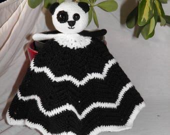 black and white panda plushie