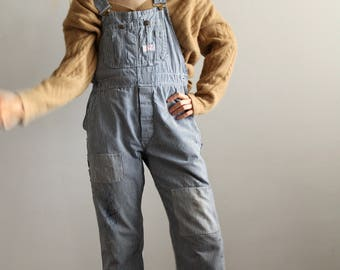 50's 60's striped overalls / patched overalls / vintage workwear / denim overalls / conductor overalls / patchwork denim