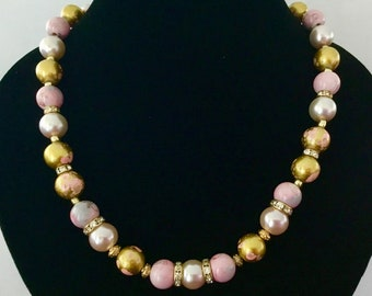 Set of necklace and earrings with pink pearls and multi shades of pink beads.pair of earrings is a gift