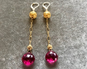 Ruby quartz drop earrings with 14kt gold chain and 24kt vermeil Bali beads on 14kt gold fill lever back earring wires