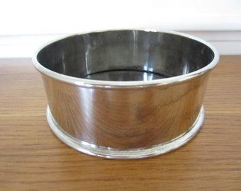 Round silver wine coaster.  Silver bar ware.  Silver and black laminate wine coaster.