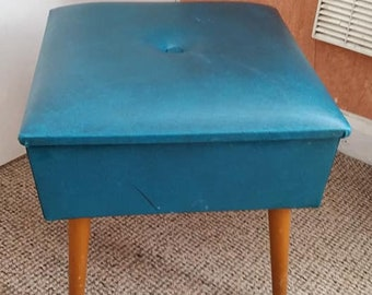 Lovely little footstool in Saturated Teal. In need of a little tlc.  Stamped, Sherbourne.