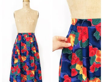Vibrant floral Jaeger midi skirt with pleats and pockets. Size S/M.