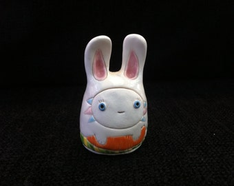 Easter Bunny with a carrot ceramic toy
