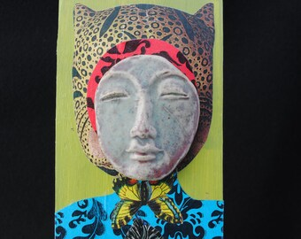 art doll assemblage, mixed media collage, mask on wood
