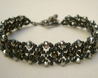 Filigree bracelet with sparkling beads in anthracite and silver