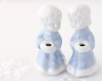 Vintage candle holders, ceramic figurines, boy & girl wearing starry blue robes, winter holiday Christmas decor