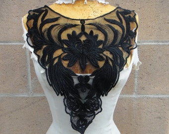 Black color embroidered applique 5 1/2 inches wide at the neck 3 inches wide at the shoulder 13 inches long center down