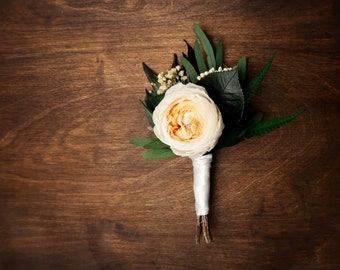 Groom's wedding boutonniere with real peach English rose peony, preserved flowers eucalyptus greenery, elegant boho style, realistic flower