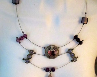 Vivian,   layers of purple metal elements, glass, agate, guitar strings, geometric, handmade, contemporary,textured, ,sculptural,