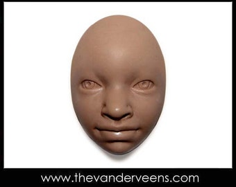 Mold No.85 (Face- African child or with opened eyes) by Veronica Jeong
