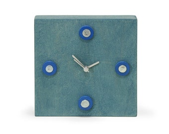 Blue clock with blue discs