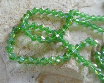 Set of 40 beads bicone glass peridot green AB, 6 x 6 mm, hole: about 1 mm