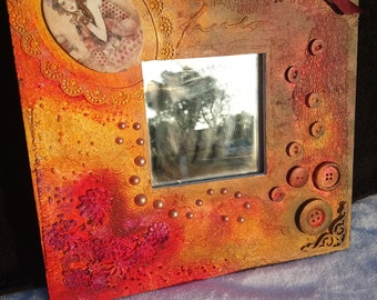 An original one off picture frame or mirror made by myself. Vintage/textured and colourful