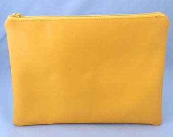 Nappy clutch/pouch made in Yellow faux leather. Colourful wash bag, travel bag, zippered bag, nappy bag. Gender neutral. Bright colour pop.