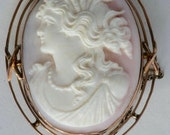Carved pink cameo with go...