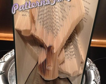 Book folding pattern for a GUITAR and MUSIC NOTES