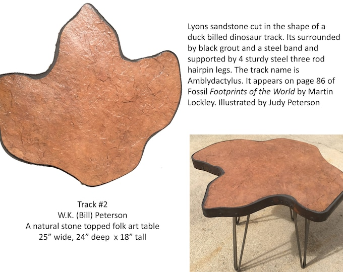 "Track #2: A natural stone topped table in the shape of a dinosaur track.  25""x24""x18"" tall"
