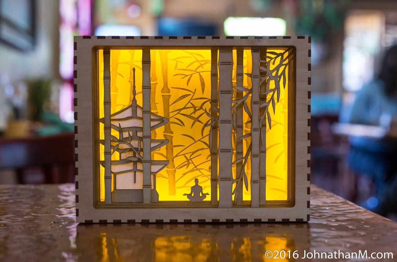 in shadow box light box luminary laser cut
