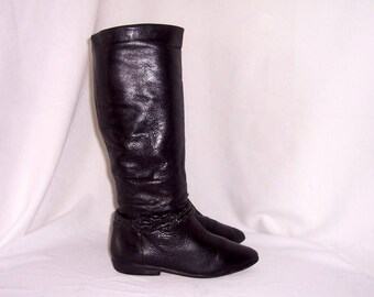 Sz 6 M Vintage Tall Black leather 1980s women flat riding boots with braided ankle strap.