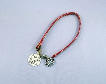Bracelet with copper zipper string with Live, Laugh, Love and Crown Pendants