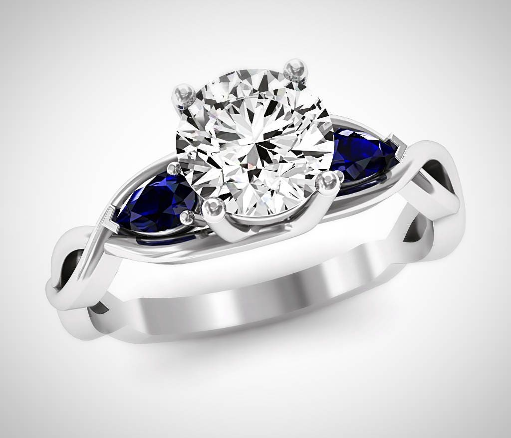 sapphire blue meteorite moissanite ring and wedding pin engagement band
